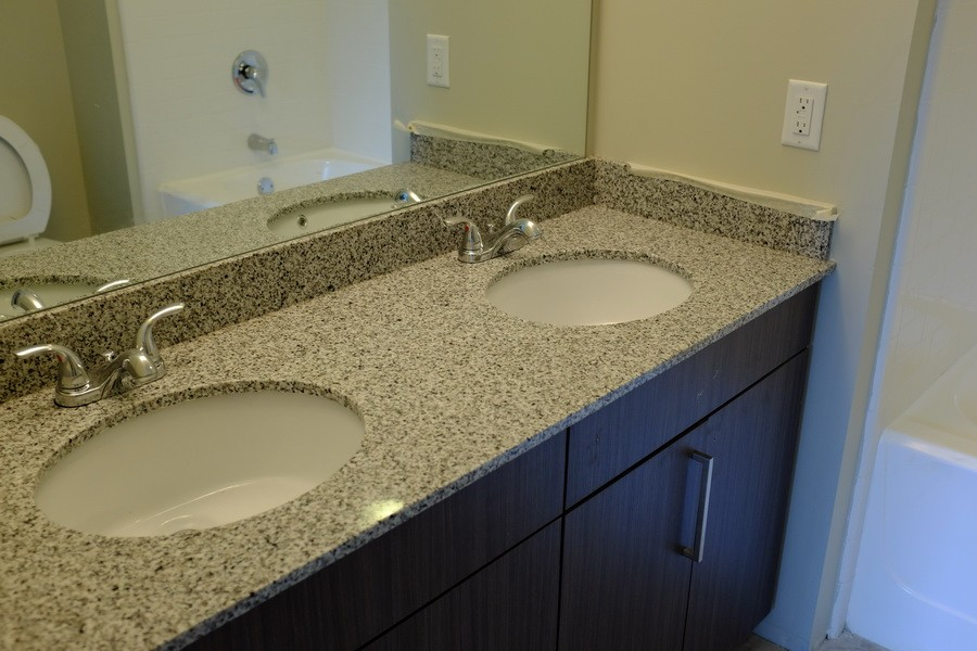 Granite bathroom countertops cost china granite for Corian cost per square foot